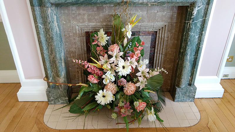 Flower decoration in the fireplace setting