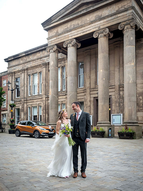 Wedding couple outside the front of Macclesfield Town Hall